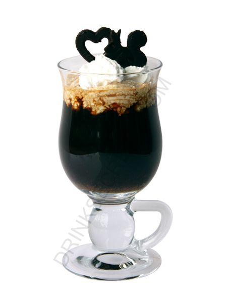 Jamaican Coffee- Dark Rum, Kahlua, Coffee, Whipped Cream. YUM!