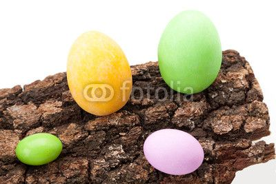 Stock photo at Fotolia: Easter Eggs On Bark