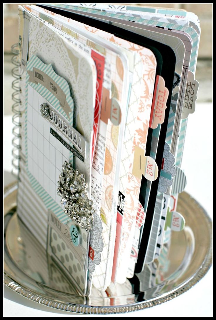 Inspiration: Memory Journal by Teresa Collins.  Love the brooch & the circle tabs.