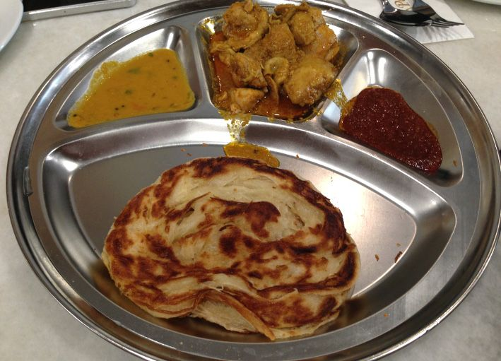 Roti Canai with curry chicken.