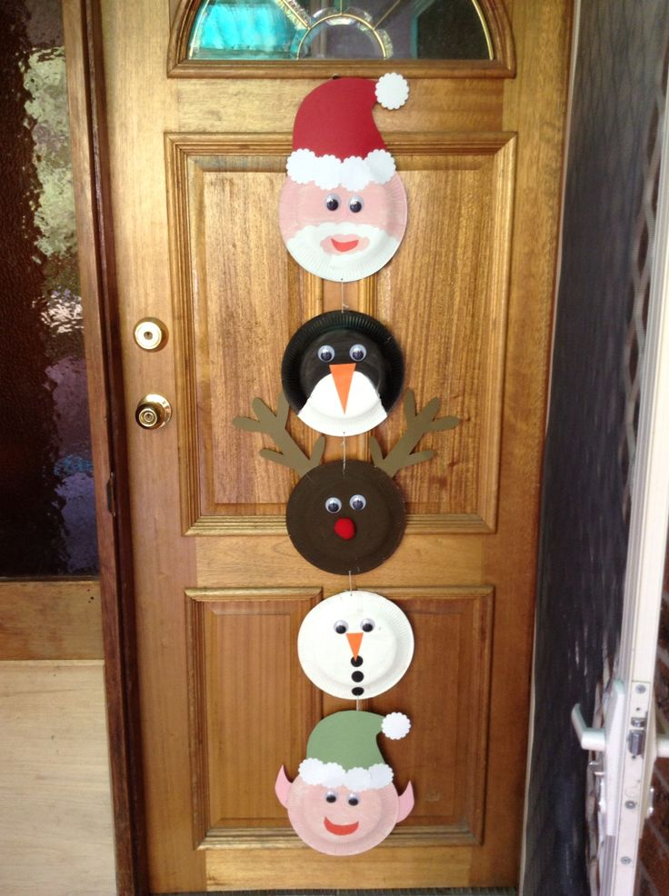 A door hanger for christmas. Made with 7 year old brother.   Painted plates, cut out cardboard, googly eyes.  Easy to make with kids.  Perfect christmas craft.