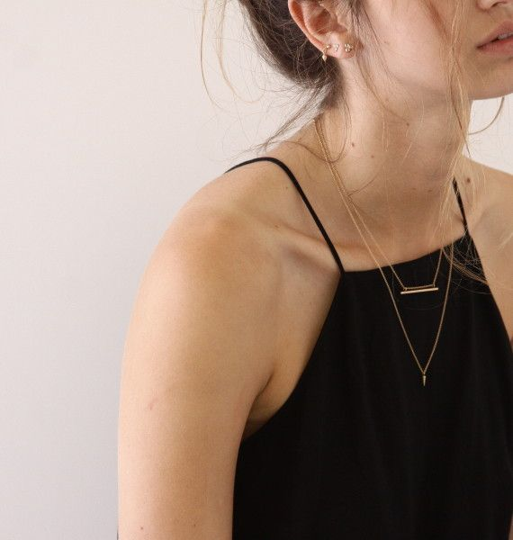 Two Small Necklaces Over A High Neck Little Black Dress