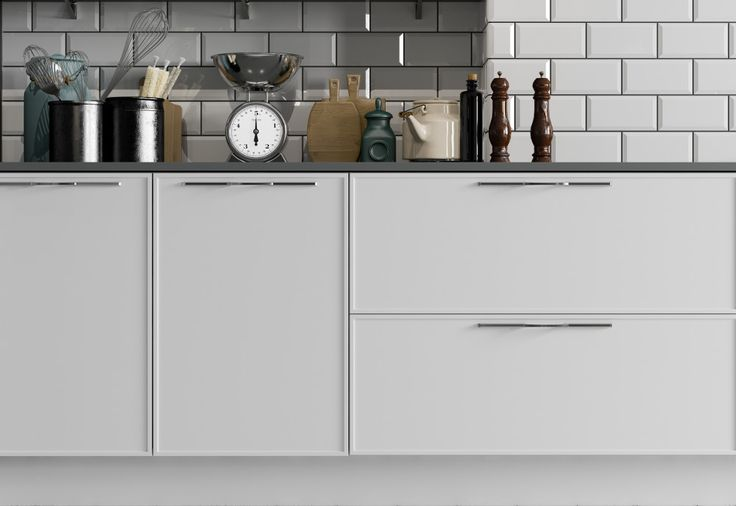 Quadra showcases modular styling in kitchens. Shown here in White.
