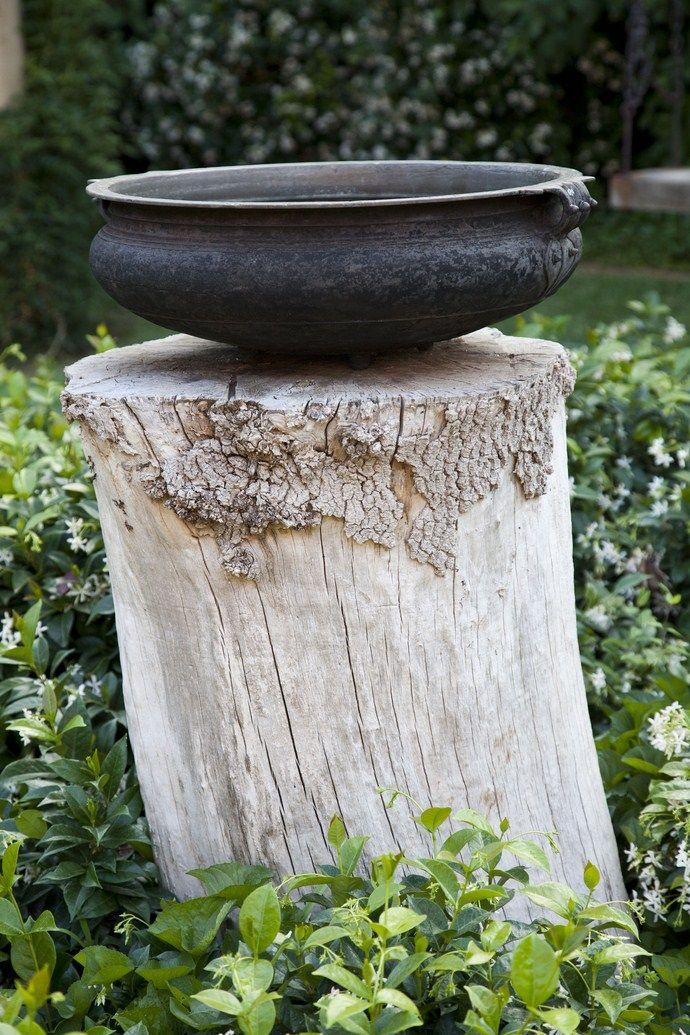 natural wooden plinth and iron bowl - garden sculpture