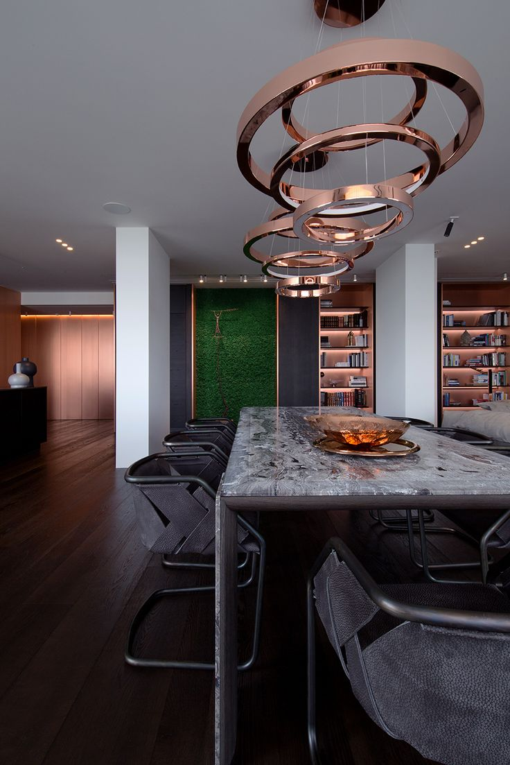 Moss in combined living-dining-kitchen space. Designed by YoDezeen architects