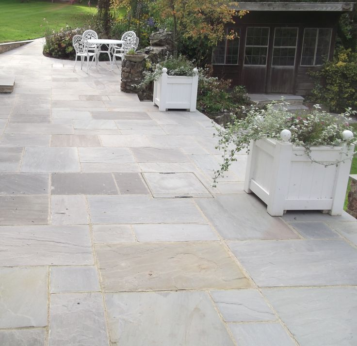 Natural Indian Sandstone in Grey has been used to transform the back garden of an old village property.
