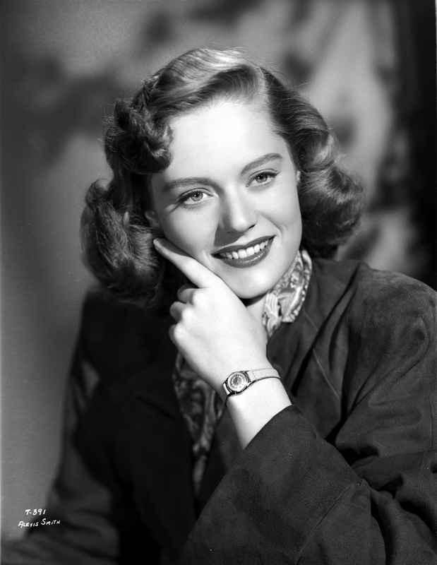 Alexis Smith smiling in Portrait with Wrist Watch High Quality Photo – Movie Star News