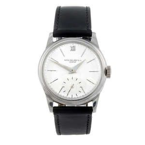 LOT:262 | PATEK PHILIPPE - a gentleman's stainless steel Calatrava wrist watch.