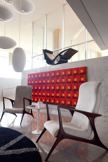 White chairs in a bedroom of the Brasilia palace by Oscar Niemeyer