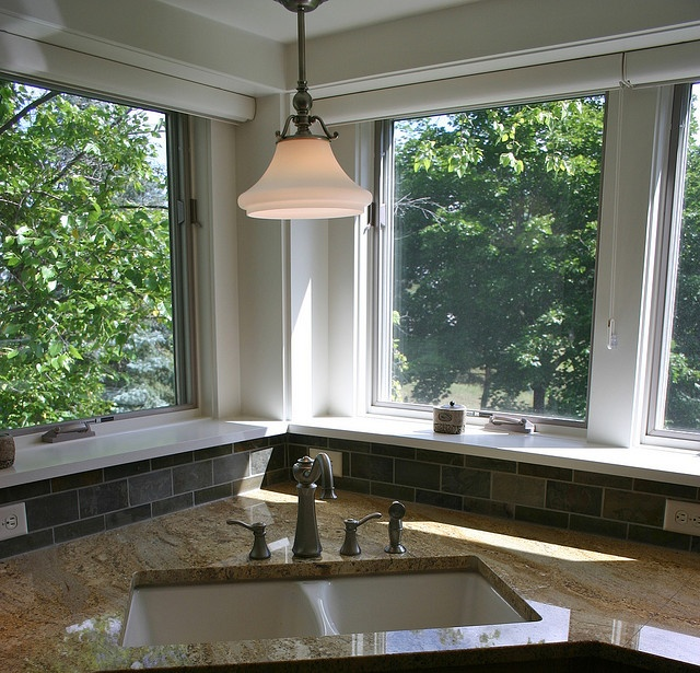 corner sink open windows granite and stone tile light and faucet