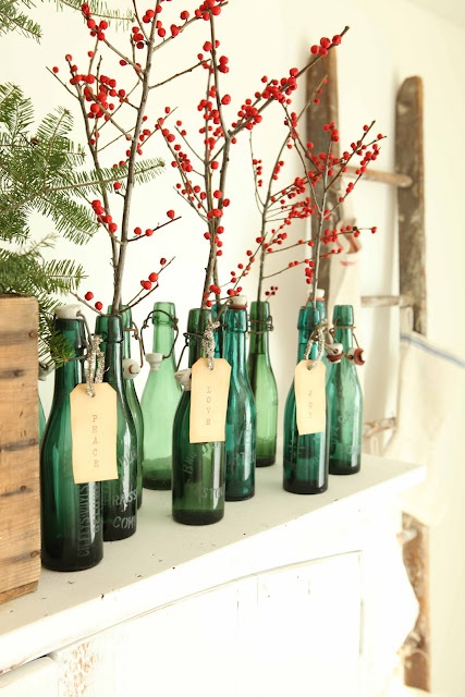 green bottles with tags, filled with berried branches