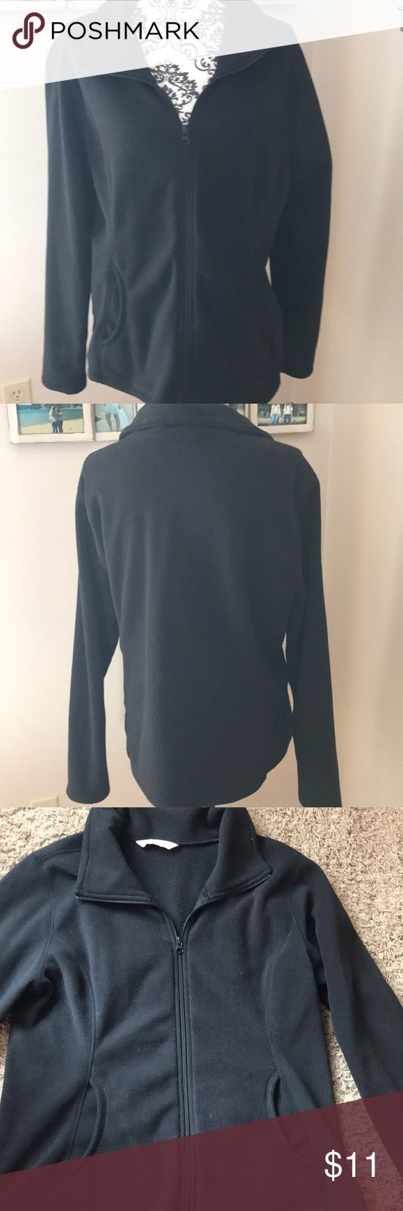 """Ladies Old Navy fleece zip up size XL Ladies black Old Navy fleece zip up. Size xl. 2 front pockets. Worn and washed once. semi fitted. Measures 21"""" pit to pit and 25"""" shoulder to hem. Any questions please ask Old Navy Tops"""