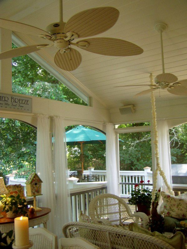 Pretty screened in porch -- with curtains!