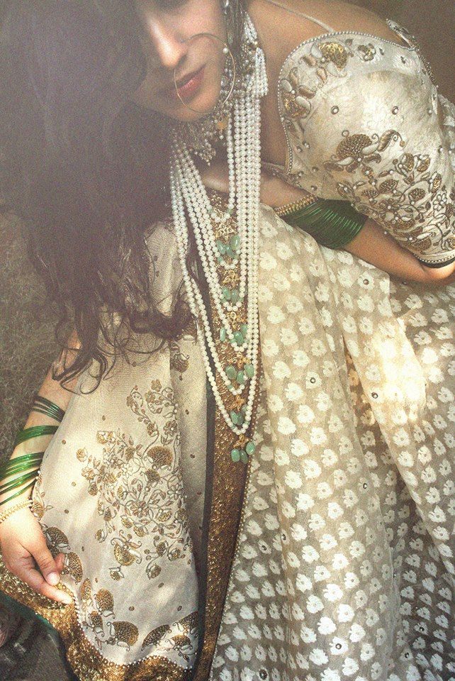 Outfit by:Dhruv Singh cream, silver, green outfit with pearls and nath (nose ring)