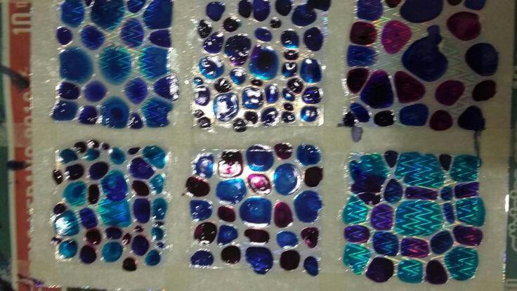 Jacarelado en azules y PVC  plateado