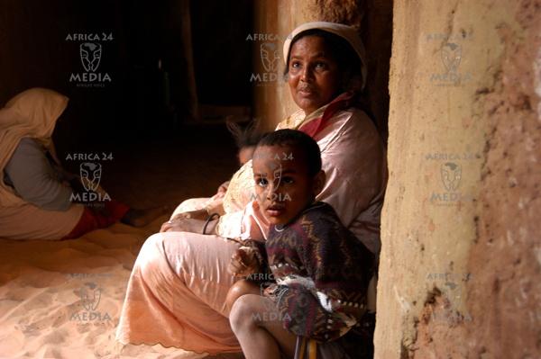 A family inside their house in Tamentit, near Adrar, in the Algerian Sahara.