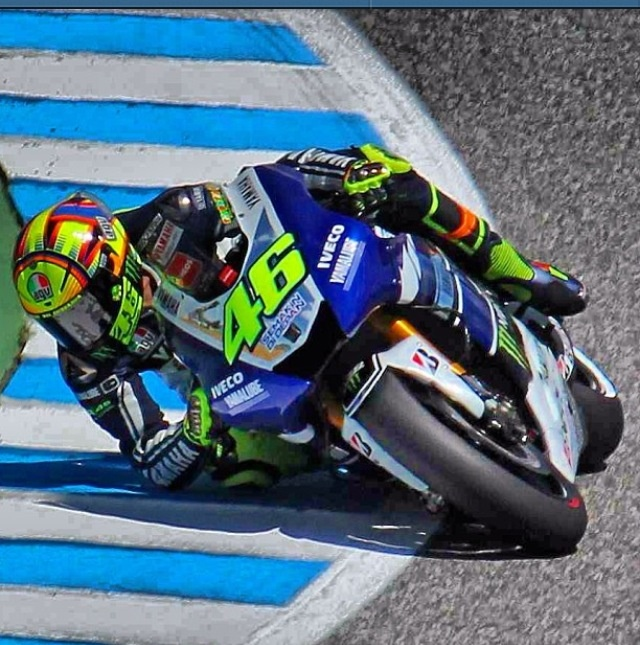 Valentino Rossi elbows down to the pavement.