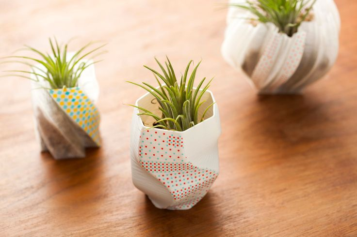 Use washi tape to deck out 3D printed vases.