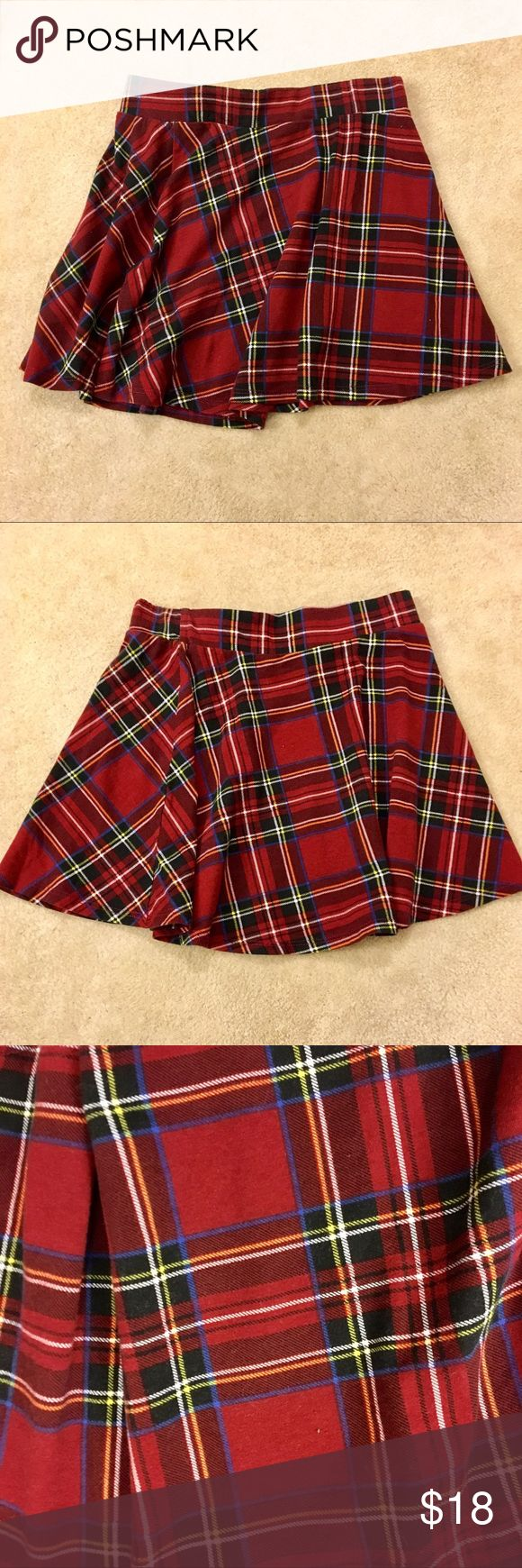 "Red Plaid Skirt - ""Schoolgirl Skirt"" Adorable red plaid skirt. Honestly, I bought this to try to look like Rachel Green but it's too small on me. The material is cotton so it is comfortable and flowy. It sits at the waist with an elastic band that stretches to fit your waist. The bottom hits mid-thigh so you can show off your legs without feeling too exposed. The measurements are as follows: Waist: 26 in Length: 15 in Bottom circumference: 30 in Skirts Mini"
