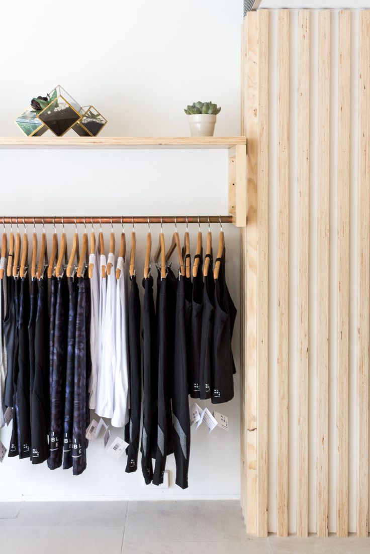 Activewear Rack // Wooden Paneling & Copper Finishes