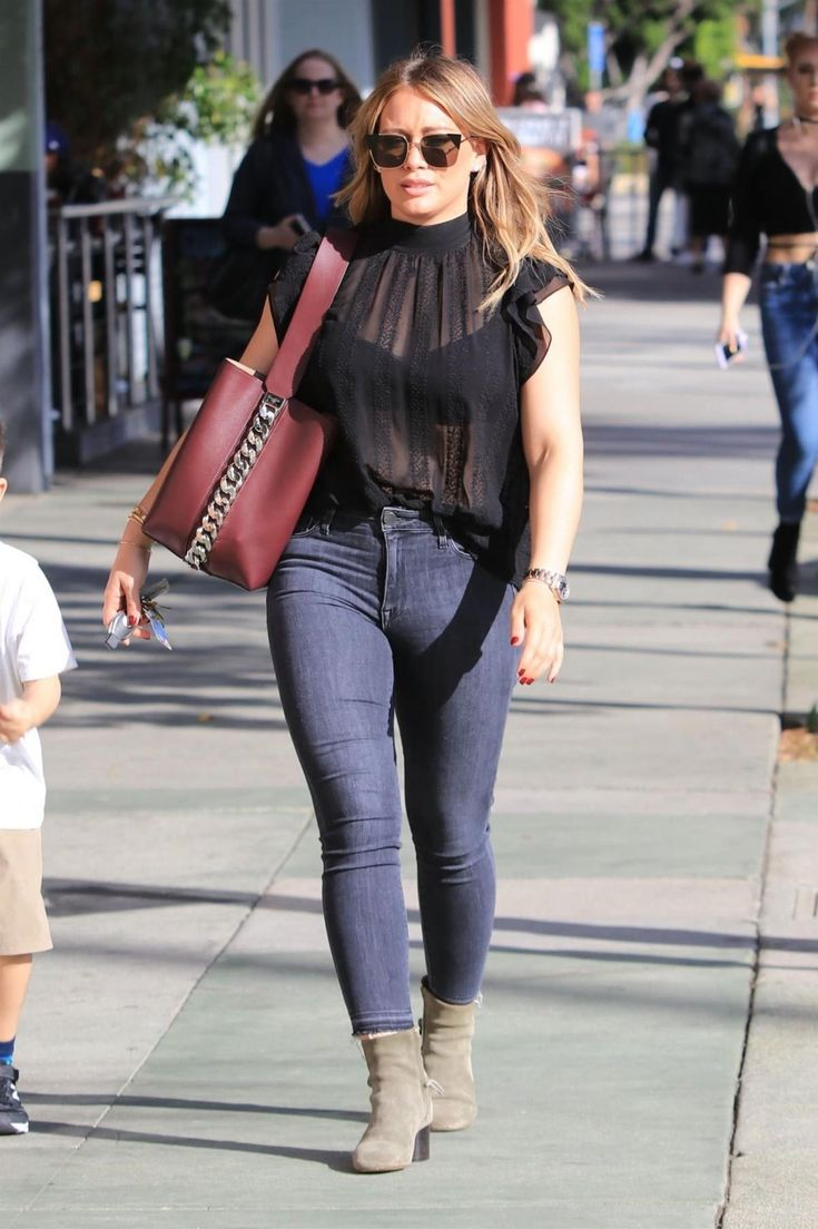 Hilary Duff wearing Fendi Ff0191/s Tipped Cat Eye Sunglasses, Givenchy Infinity Chain Bucket Bag in Oxblood and Parker Smith Bombshell Jeans in Tower