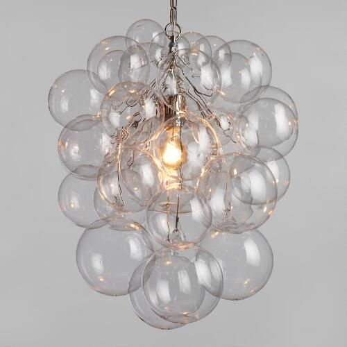 A bold lighting statement with the organic form of a sculpture, our chandelier is composed of 34 hand-blown glass orbs bubbling around a nickel-finished interior shade.