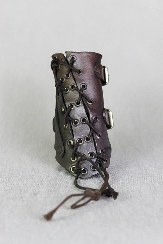Dystopian Fallout Bracelet - Warrior Bracer - Leather Vambrace - Wasteland Wrist Band - Dystopian Leather Cuff - Cuff Bracelet  Designer of the project is Viola Sychowska, founder of Wasted Couture collective. Leather work is made by Szpaku, member of Wasted Couture collective.  Post apocalyptic bracelet is handmade from leather. The inspiration cames from postapocalyptic warriors. It is prefect to express your passions in daily routine, but also good for LARP games, movie or photo prop…