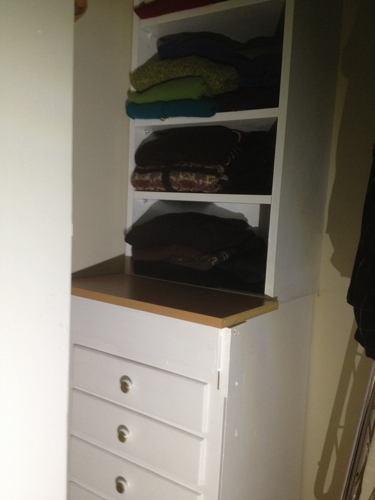 Closet organizer with 4 drawers built for $30 with pieces from Habitat for Humanity's ReStore store.   It's solid too--none of the pieces are actually attached to each other or the wall. So it will be easy to take with me when I move.