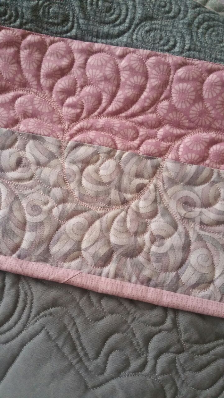 Pieced ana Appliqued by Sue Marrs. Quilted by Merle Gilson.