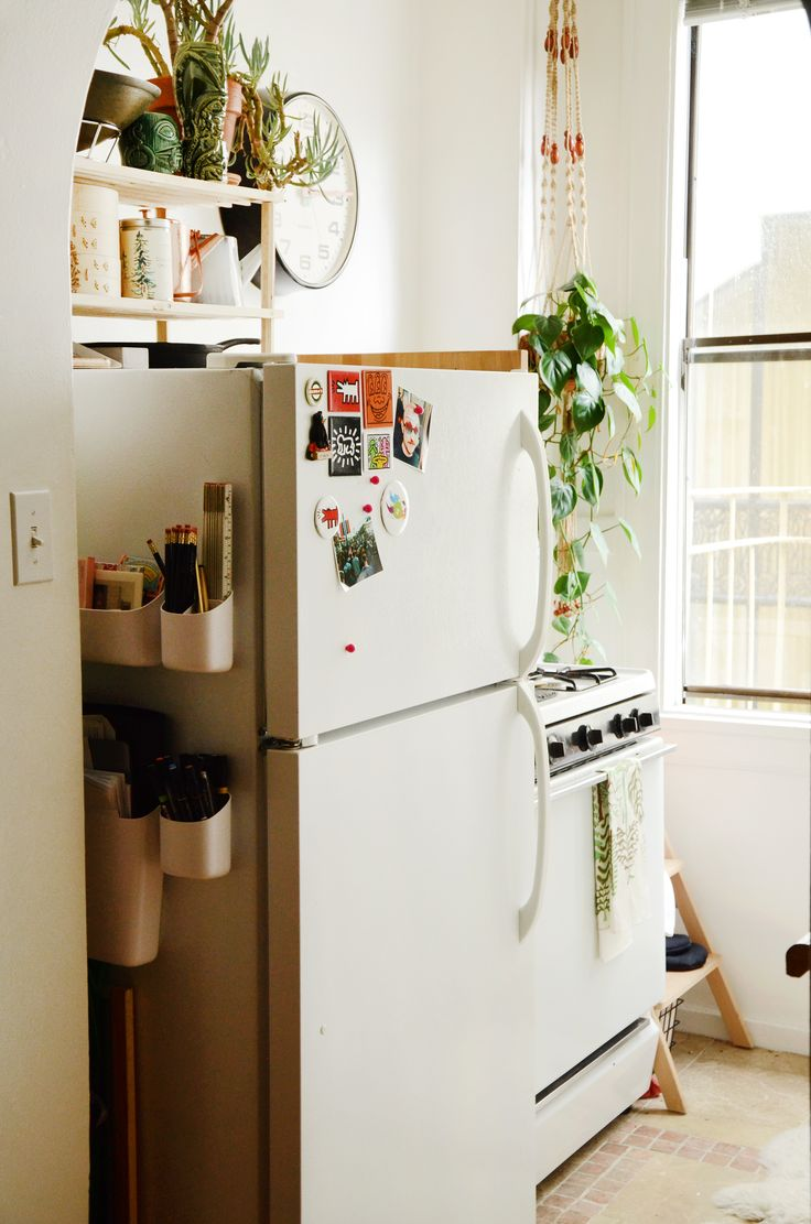 The small but bright kitchen; tucked behind the fridge is extra storage that holds Jory's drawing tools.