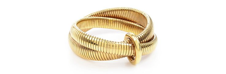 Gold tubes make for a key motif in Diane von Furstenberg's first collection of costume jewelry.