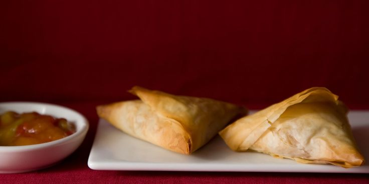 Get the irresistible flavor of samosas without all the frying. Phyllo (left over from Roasted Winter Vegetable Baklava         ) makes an ingenious wrapper for our take on the popular Indian snacks, although the filling of garam–masala–spiced potatoes and peas is quite traditional. They bake up light and crisp, ready for a dip in chutney or raita. Serve these samosas with a salad for a vegetarian main course, or make smaller ones as appetizers.
