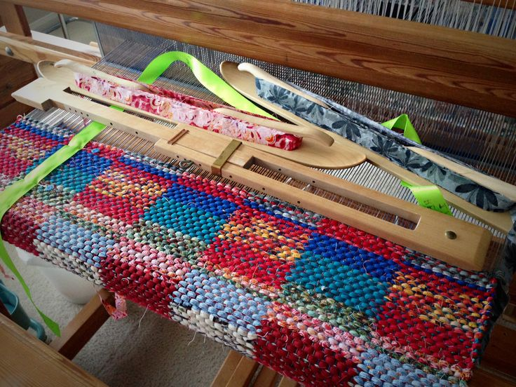 Weaving sunsets into a rag rug on the loom.