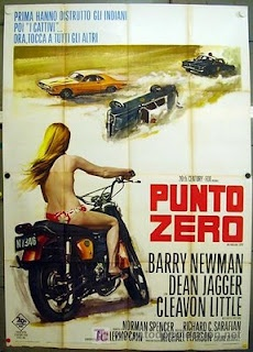 """The Italian Movie poster to one of my favorite films Vanishing Point. This is the film that inspired Tarantino's Death Proof. The headline reads, """"First they destroyed the Indians, then the bad people. Now it's everyone else's turn."""" What this description has to do with the film is beyond me. Plus, the signature white Dodge Challenger is orange on this poster."""