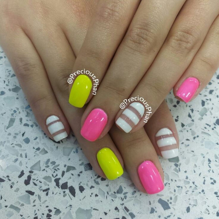 neon yellow and pink with white strips nail art design