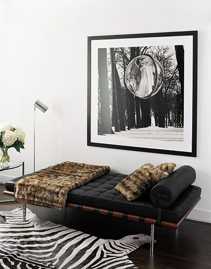 Mies Van der Rohe day bed + cowhide rug + fur throw + nickel & glass end table + black & white photography= SO MY STYLE