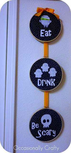 embroidery hoop art.  Its a bit too cutesy for me but I love the idea!