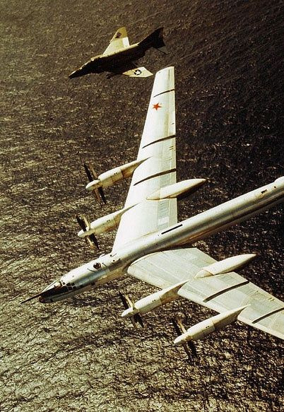 An American F-4 Phantom shadows a Soviet Tu-95 nuclear bomber as it approaches US airspace