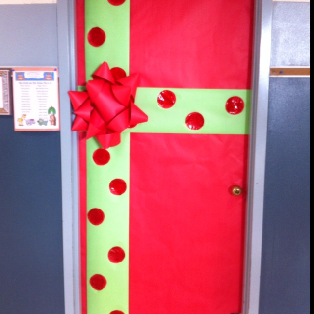 classroom door for December! This would be even cuter if it had little presents with the children's name on them..