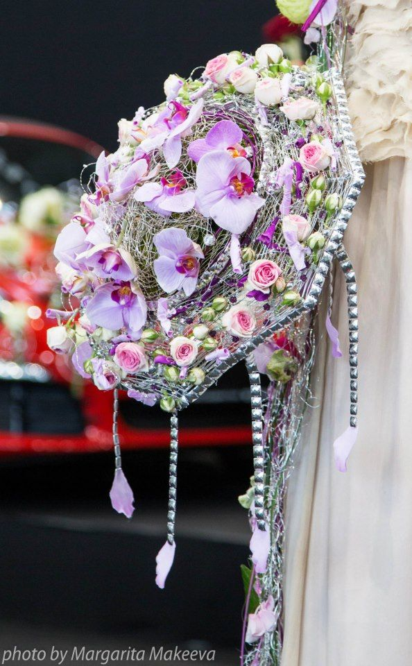 Bridal bouquet featuring roses, orchids, rose petals, rose budes