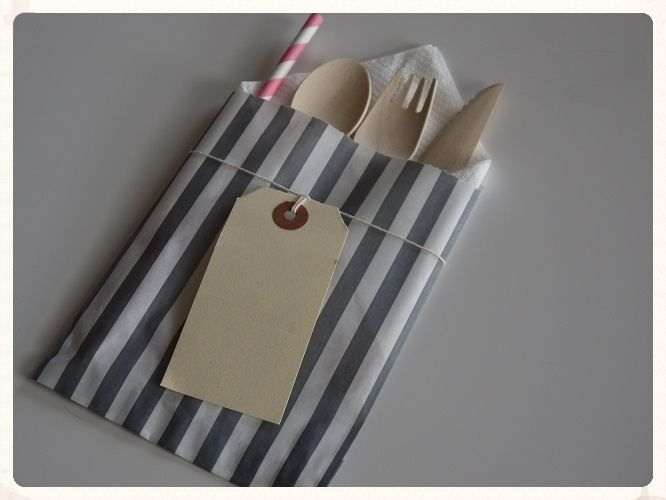 Ten individual cutlery packets each includes a wooden knife fork and spoon as well as a paper napkin and pink paper straw all wrapped up in a grey