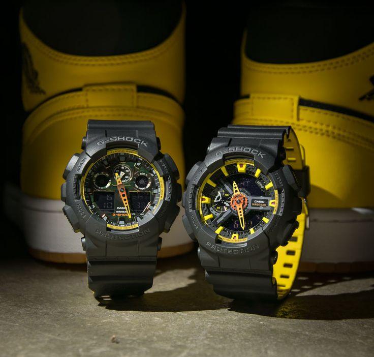 """Schwarze G-Shock GA-100BY-1AERvon Casio mit Double-Layer Armband aus der """"Black & Yellow"""" Serie. Die GA-100BY-1AERpräsentiert sich mit schwarzen Knöpfen, einem Display in Camouflage und grauer Beschriftung auf dem Gehäuse...."""