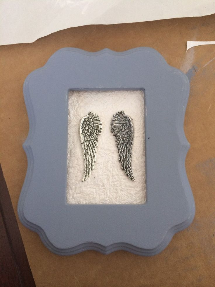 Framed angel wings - such a sweet touch as #nursery #walldecor