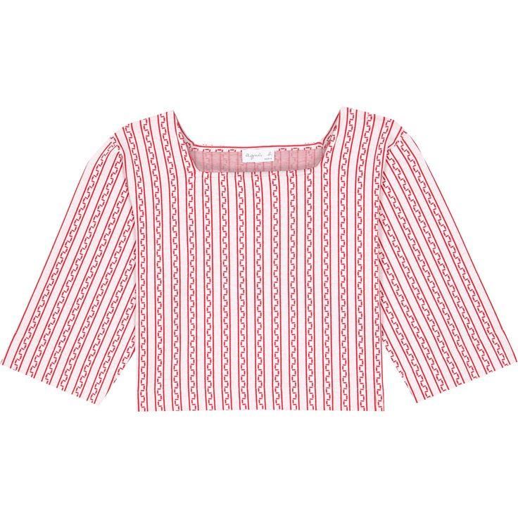 top carré graphique Avec son imprimé graphique estival, le top carré est une pièce incontournable de la saison. En jersey imprimé rouge et blanc, ses manches 3/4 et son encolure carrée lui apportent une coupe droite mais décontractée.
