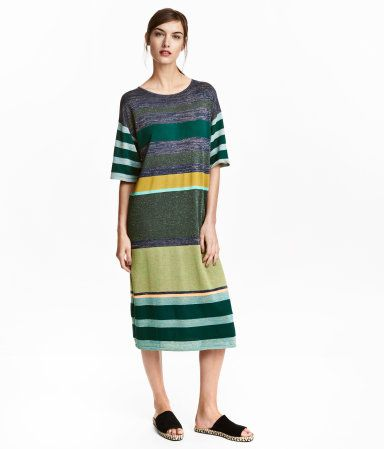 Fine-knit, calf-length dress in viscose with glittery threads. Dropped shoulders, short, wide sleeves, and slits at sides.