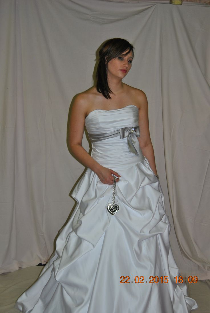 White wedding dress with silver bow