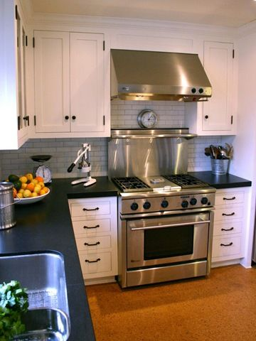 L shaped kitchen layout. black counters and white cabinets kitchen