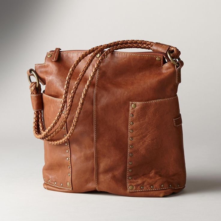 """FOUNDRY SLOUCH BAG--Big, wraparound pockets soften the silhouette of our zip-top studded leather tote bag. A classic re-envisioned exclusively for Sundance by Ellington. Exquisite leather, antique brass studs and triple braided straps. Six pockets. Imported. Approx. 11""""W x 4-1/4""""D x 14""""H."""