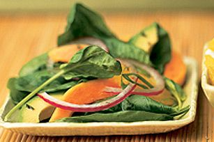 Try a taste of the tropics in this easy recipe - sliced papayas, avocados, onions and oranges top a bed of fresh spinach leaves for a tasty, refreshing salad.