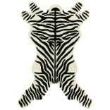 Maybe an imitation zebra rug is morally less complicated ($183.99 at Overstock right now)